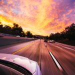 HDR photograph of car driving on highway