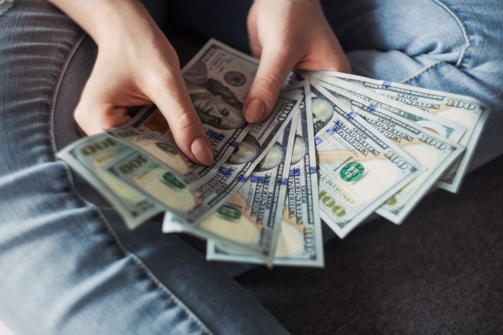 Girl holding American dollars
