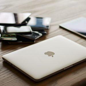 MacBook, iPad and other gadgets on desk