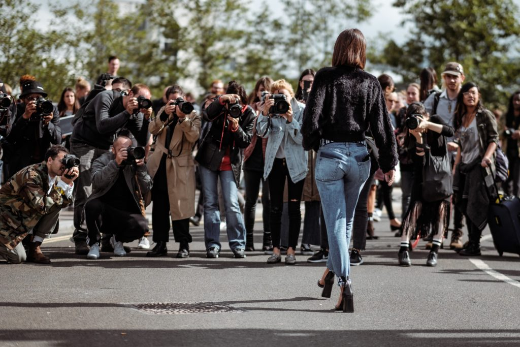 Paparazzi takes photographs of model at London Fashion Week 2017