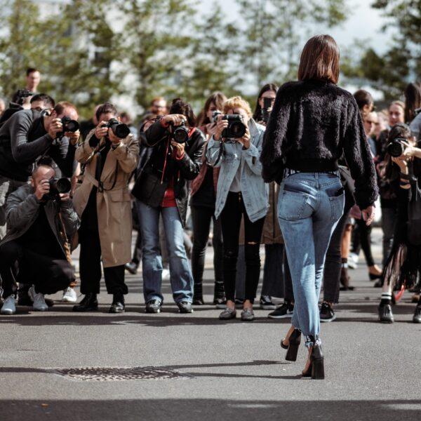 Paparazzi takes photographs of model at London Fashion Week 2017