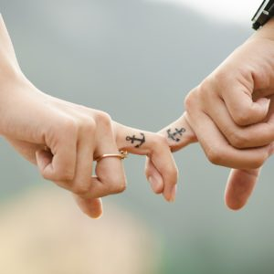 Two people linking fingers