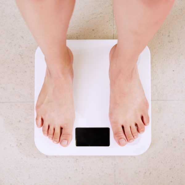Person standing on digital bathroom scales