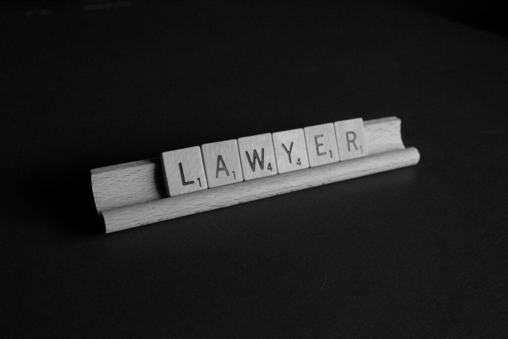 Scrabble tiles spelling 'lawyer'