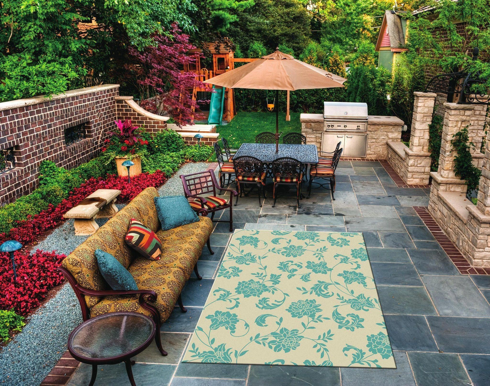 Stamped concrete, outdoor rug and patio furniture