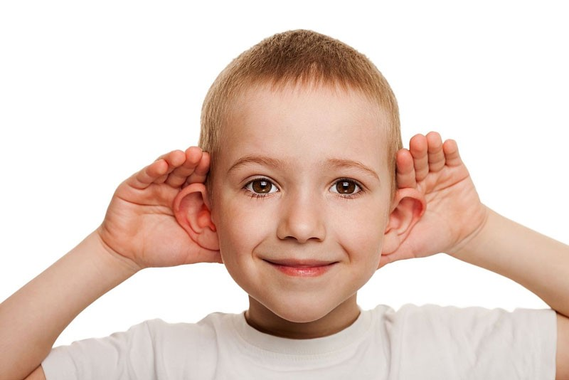 Child pushing their ears forwards