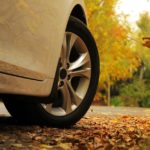 Wheel of a car and Autumn leaves
