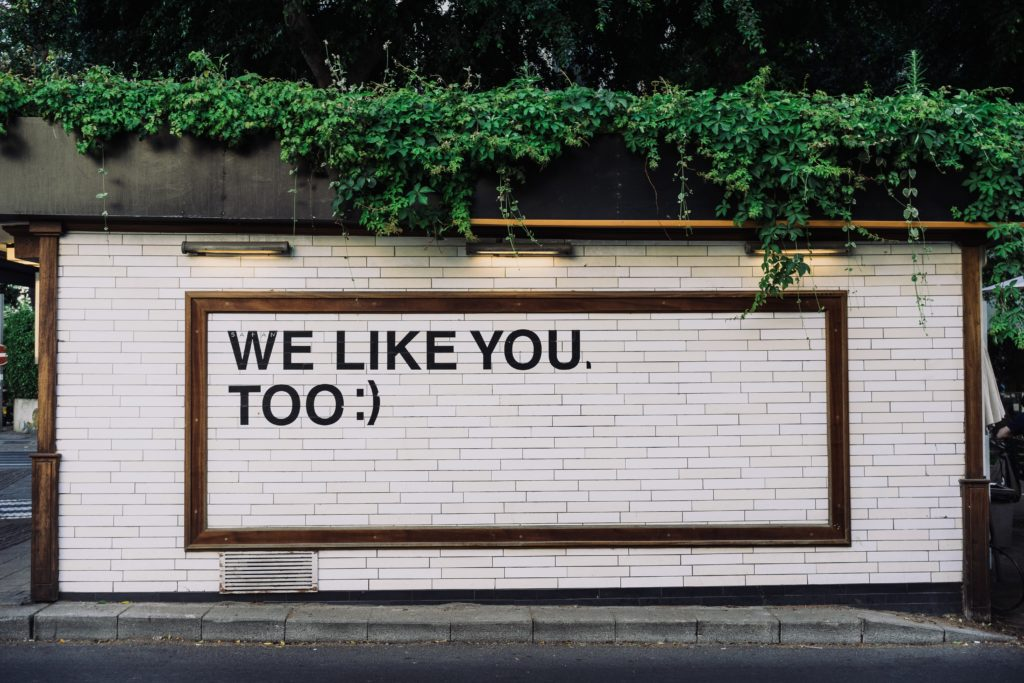 "Wall with ""We like you too :)"" written on it"
