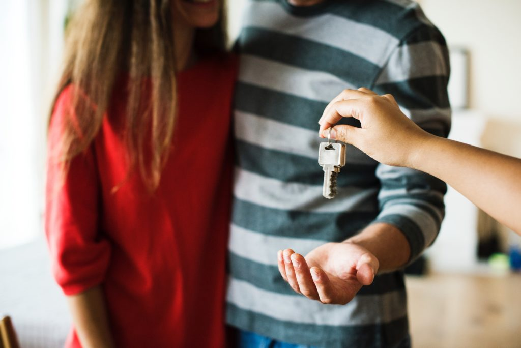 Couple accepting key to property