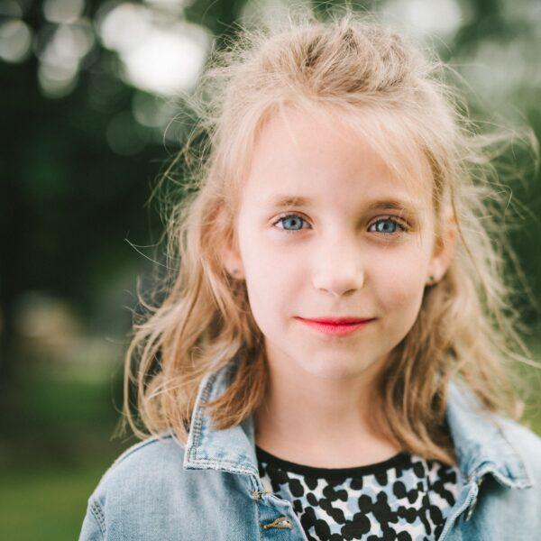 Smiling girl wearing blue denim jacket