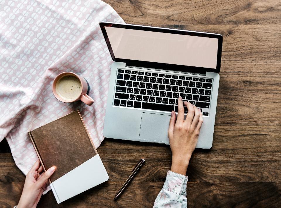 Notebook, mug and MacBook