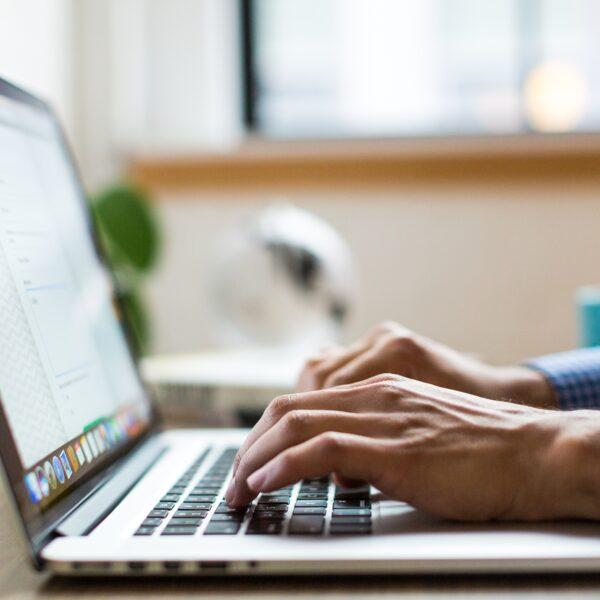 Man using MacBook on desk