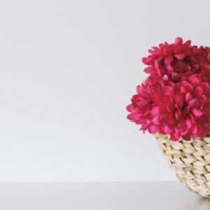 Pink flower inside wicker basket