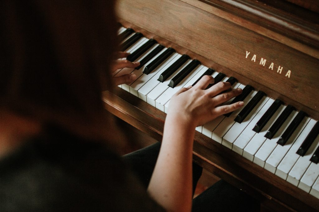 Woman playing Yamaha piano