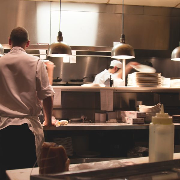 Chefs cooking in an industrial kitchen