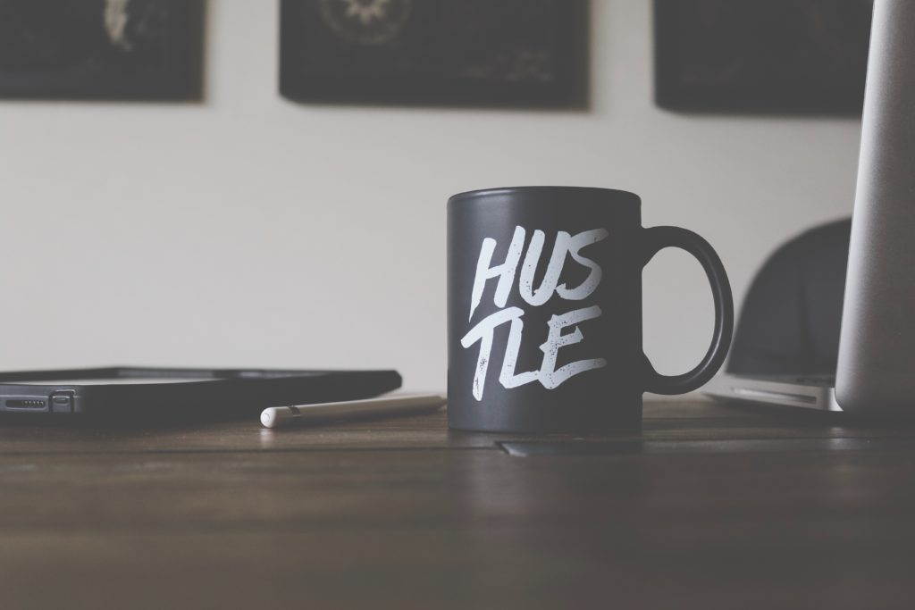 Hustle mug on table