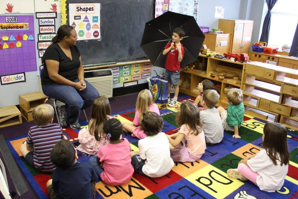 Children sitting on the floor in class