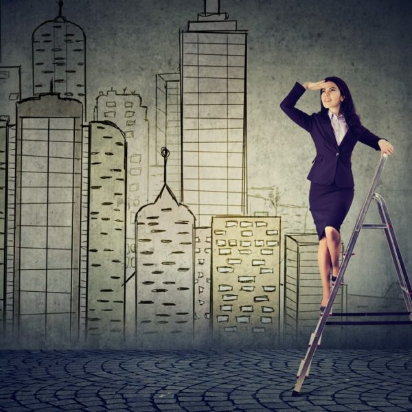Woman looking from top of ladder