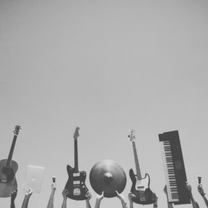 Instruments being held up by hands