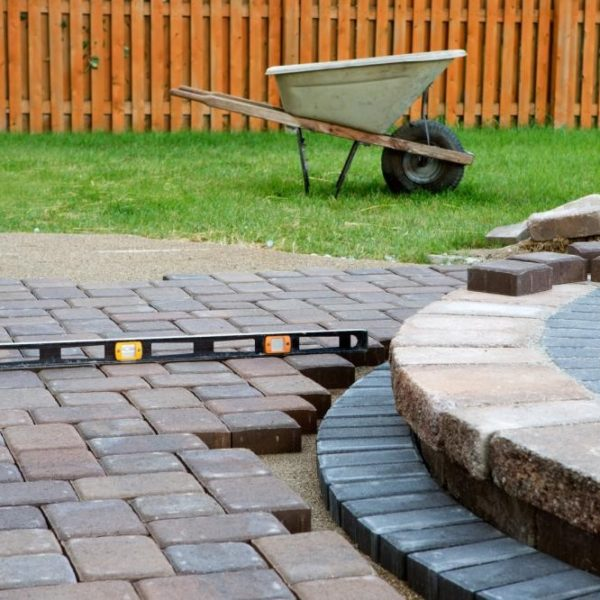 A brick patio being constructed