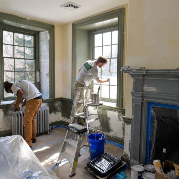 Two men painting house