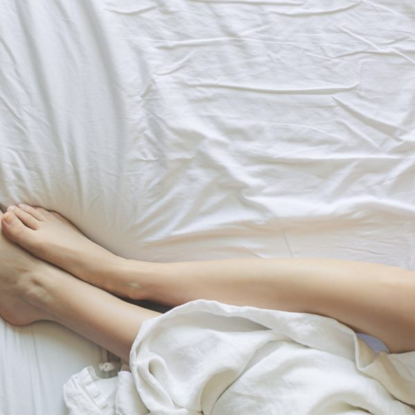 Legs partially covered with sheet
