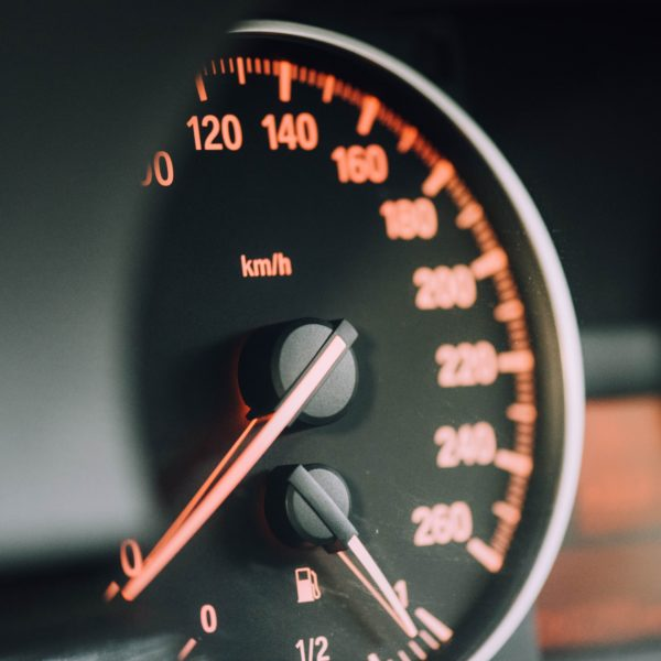 Closeup of black analog speedometer
