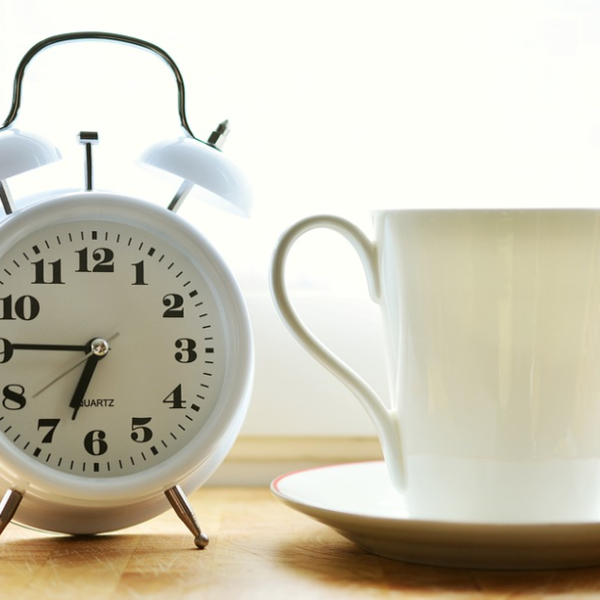 Alarm clock, cup and saucer