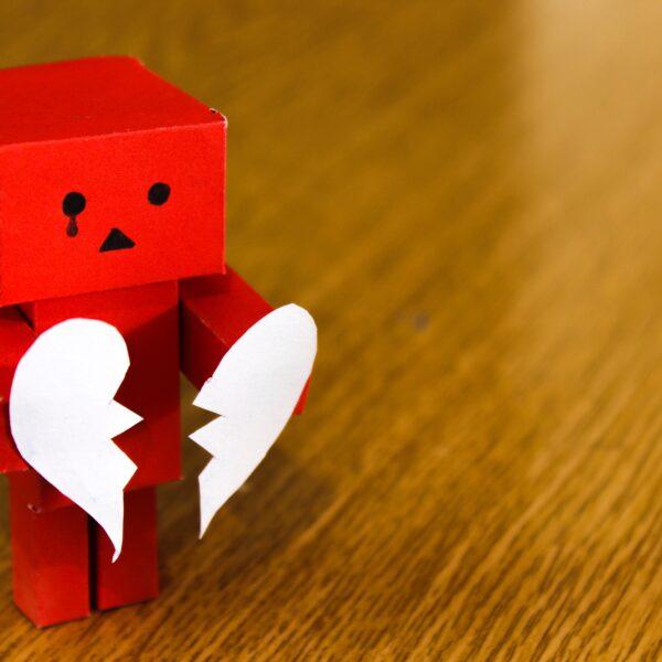 Red Danbo holding broken heart