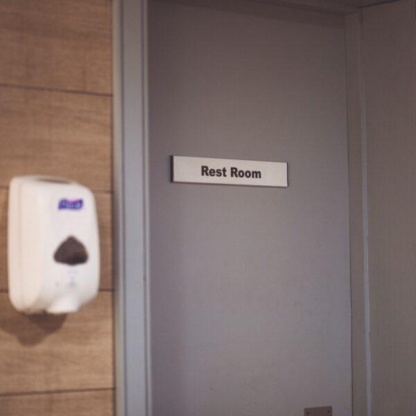 Hand dryer and rest room door