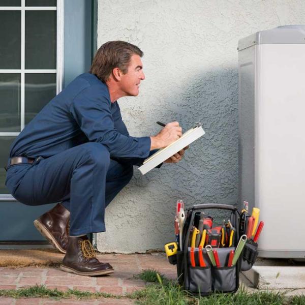 Man examining HVAC