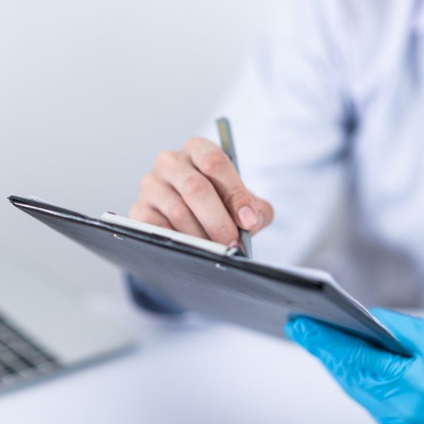Medical professional using a tablet