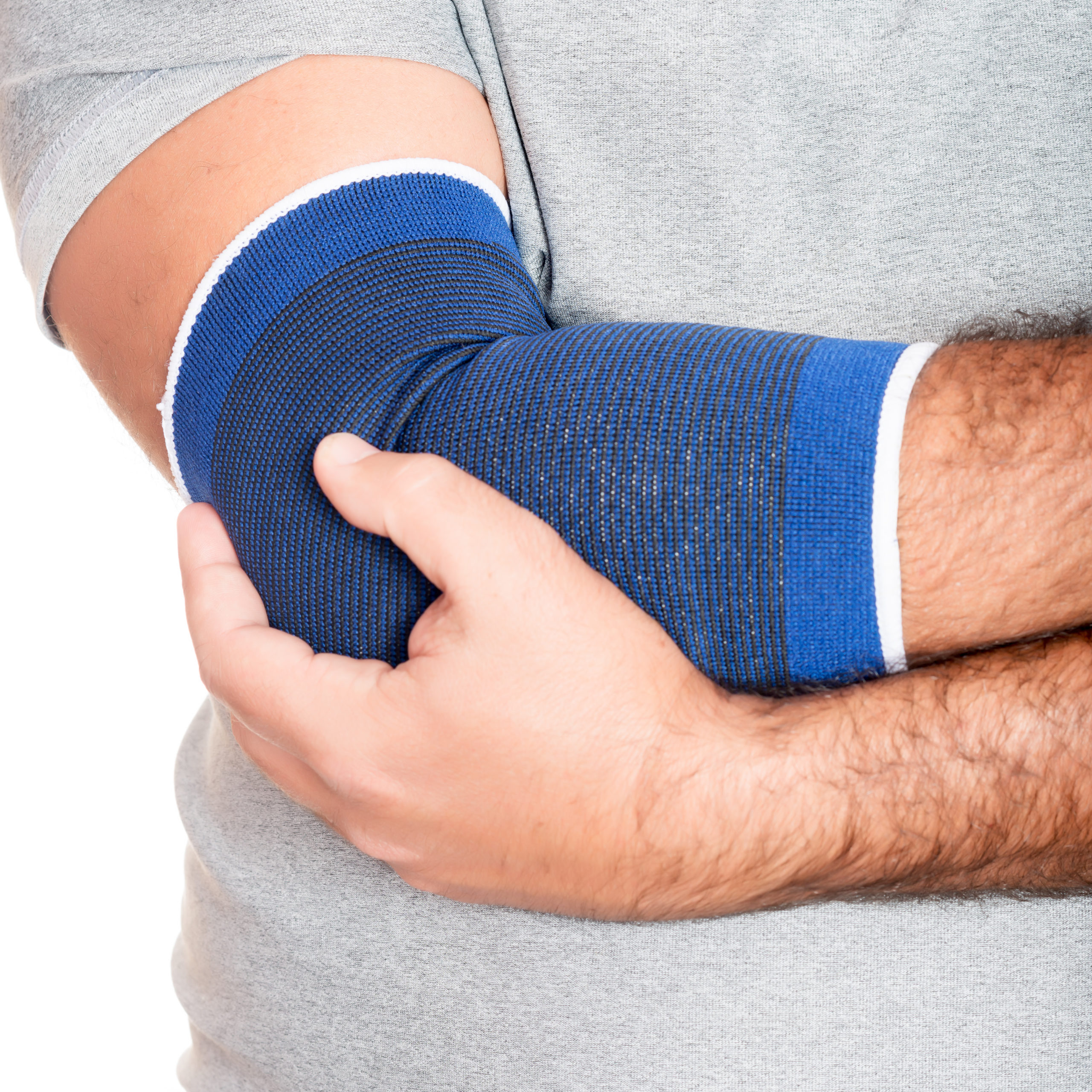 Man with a therapeutic elastic band on his elbow