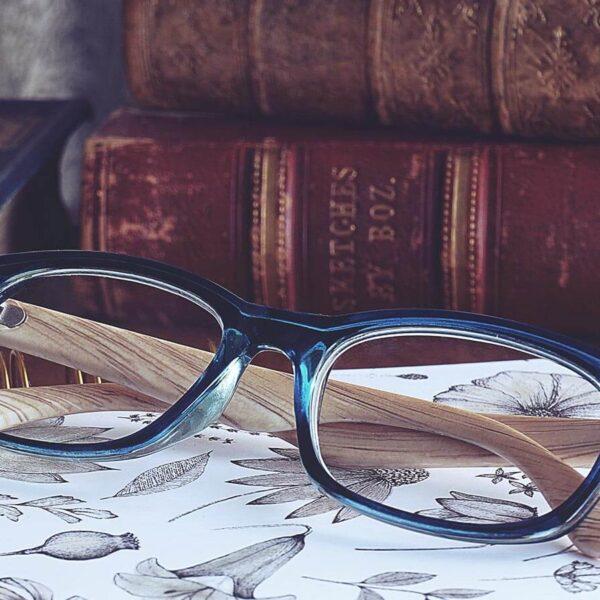 Glasses next to books