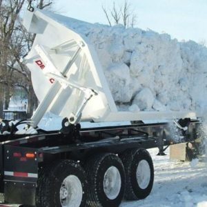 Side dump trailer with snow