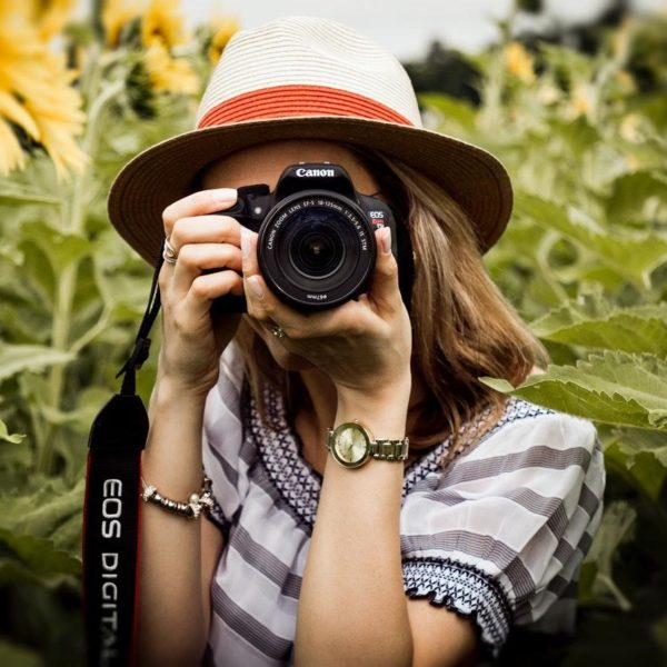 Woman using a Canon DSLR