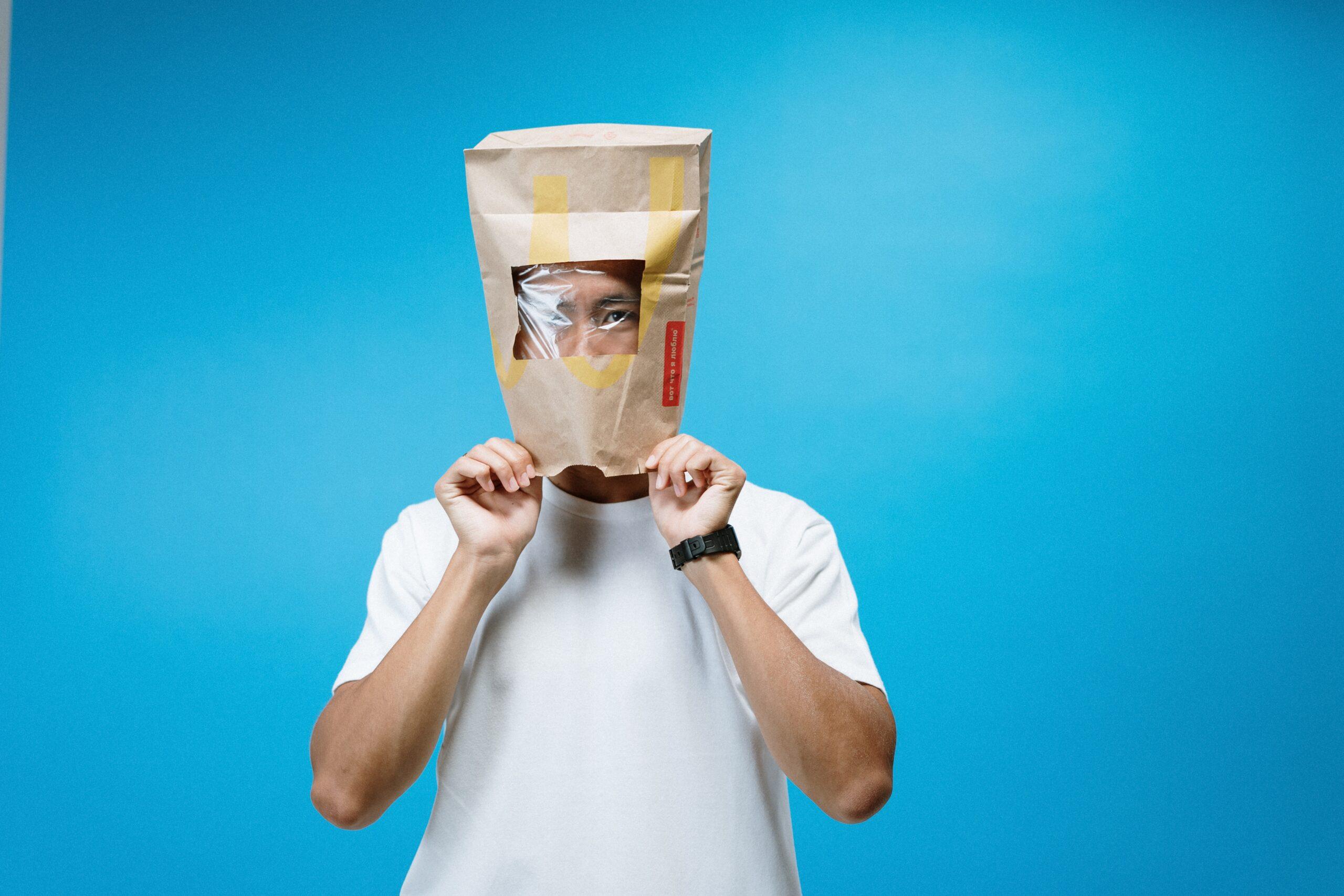 Man wearing paper bag on his head