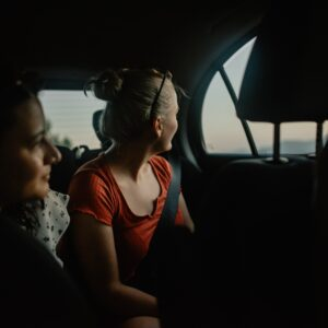 Women looking out of a car window in Cap de Formentor, Spain