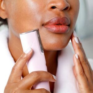 Woman using Dermaflash dermaplane