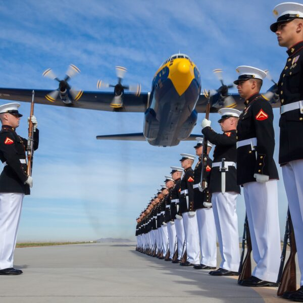 US marines with aircraft flying overhead