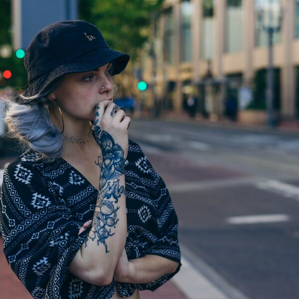 Tattooed woman wearing a bucket hat