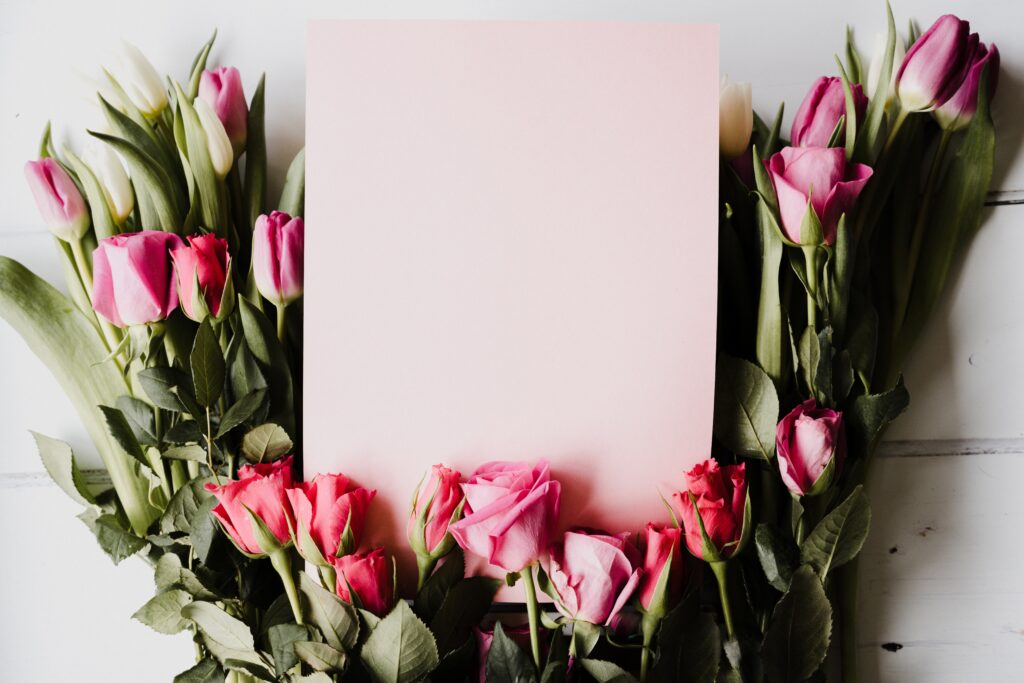 Spring tulips and roses with pink card and room for text