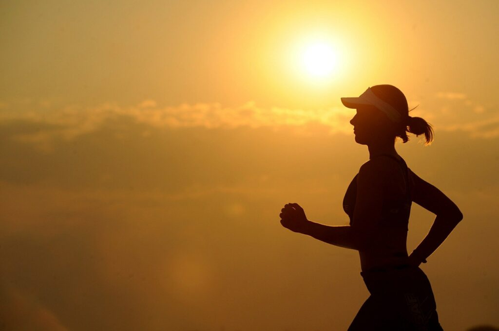 Silhouette of a woman going for a run