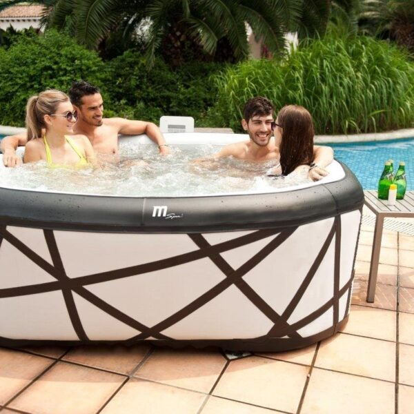 4 people sitting in a hot tub