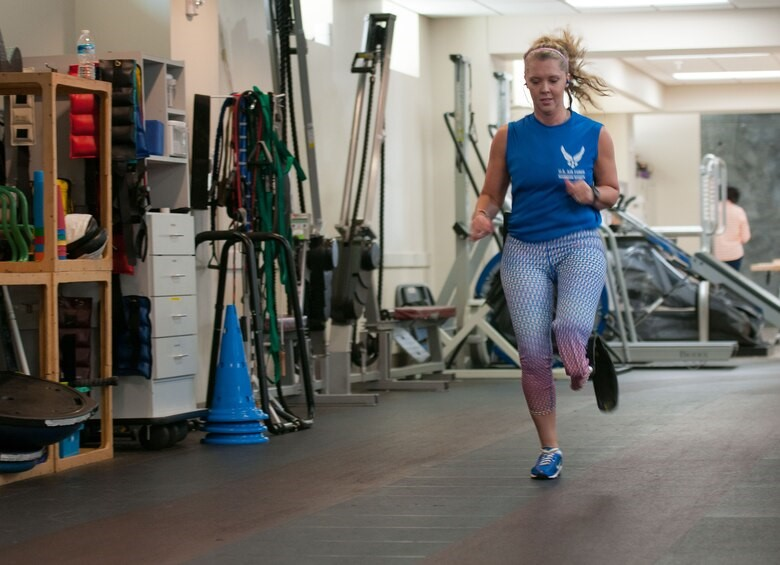 Woman running with prosthetic