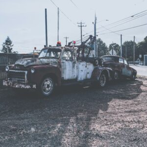 Antique truck towing an antique car