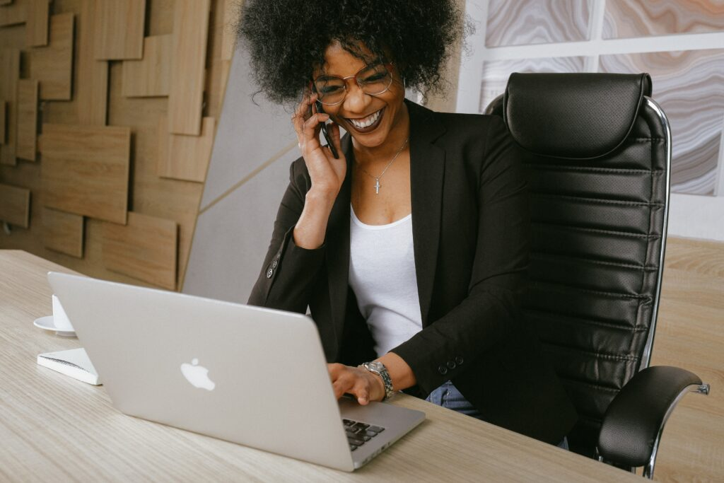 Woman in a black blazer sitting on a black office chair