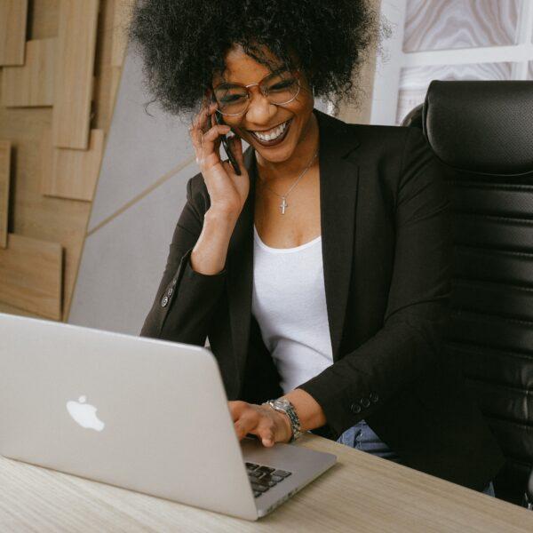 Woman in a black blazer sitting on a black office chair