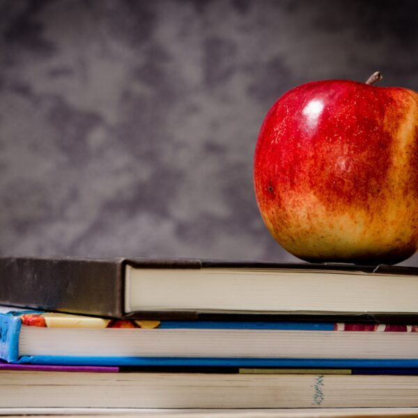 An apple on top of books
