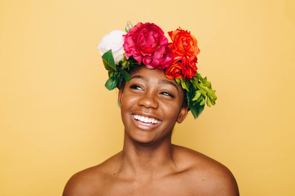 Woman smiling wearing flowers